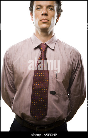 Close-up of a businessman's shirt with an ink stain on the pocket - Stock Photo