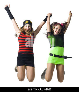 Girls in costume dancing - Stock Photo