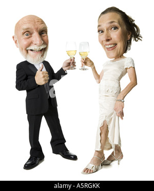 Portrait of a senior couple toasting with champagne flutes - Stock Photo