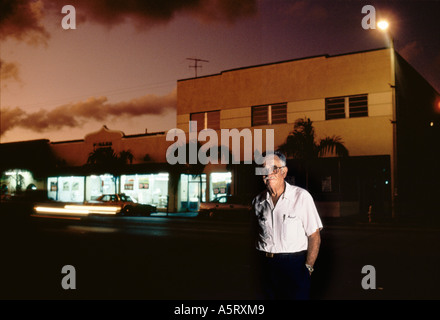CUBAN EXILE COMMUNITY MIAMI  PORTRAIT OF AN OLD MAN IN FRONT OF A FURNITURE SHOP AT DUSK IN LITTLE HAVANA - Stock Photo