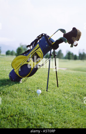 Golf bag propped up on golf course - Stock Photo