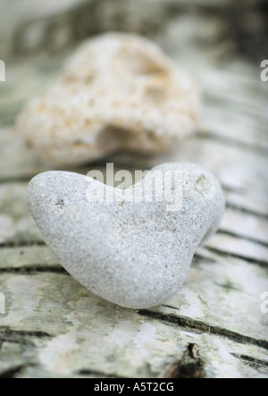 Heart shaped stones on bark background, extreme close-up - Stock Photo
