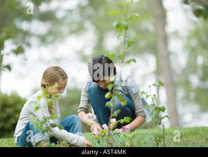 Mother and daughter doing yard work - Stock Photo