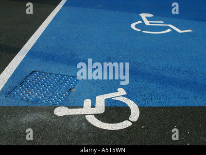 Handicapped symbols on asphalt - Stock Photo