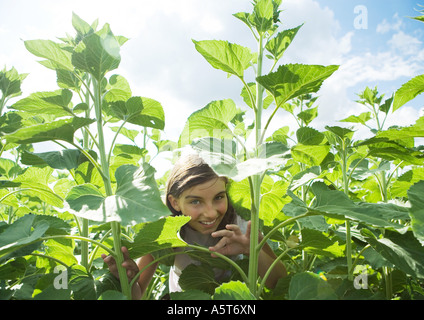 Girl standing in tall plants