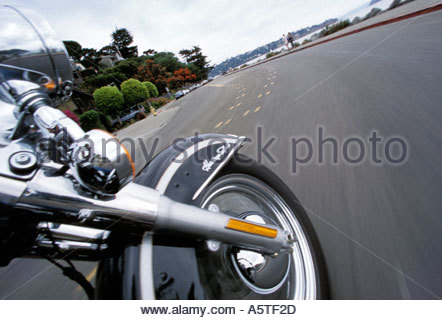 Close up of a speeding motorcycle's front wheel. - Stock Photo