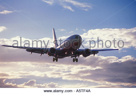 Commercial airliner landing. - Stock Photo