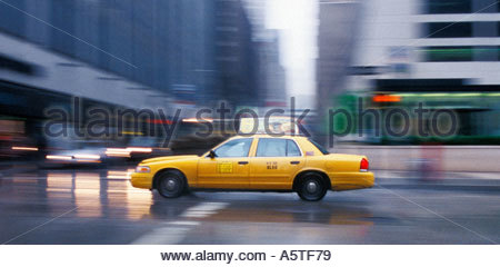 Taxicab in motion. (NYC, New York, USA) - Stock Photo