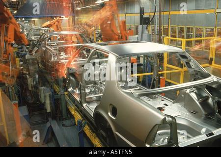 Robotics spot welding at Saab Plant in Sweden - Stock Photo