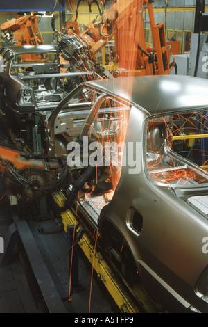 Robotics spot welding at Saab-Scania Plant in Sweden - Stock Photo