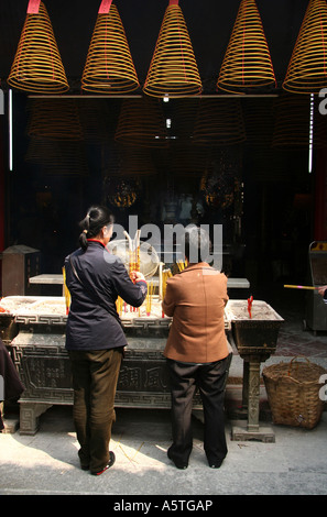 Burning Incense at A Ma Temple, Macau - Stock Photo