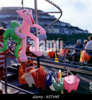 Inflatable pink panther on sale at a beach toy shop, New Quay, Wales, UK  KATHY DEWITT - Stock Photo