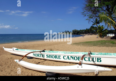 Outrigger canoes on the beach at Haleiwa North Shore Oahu Hawaii USA - Stock Photo