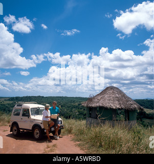 Couple on safari looking at a map at Elephant Lookout  in Shimba Hills National Reserve, near Mombasa, Kenya, East - Stock Photo