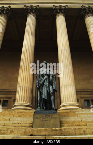 The statue of Benjamin Disraeli, Earl of Beaconsfield, stands in front of St Georges Hall, a neoclassical building - Stock Photo