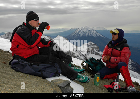 Resting climbers with El Misti in the background on Chachani, Peru, South America - Stock Photo