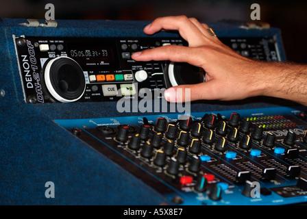DJ Using an Electronic Mixer - Stock Photo