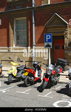 Motorcycles parked in a designated parking area on a city street in the uk - Stock Photo