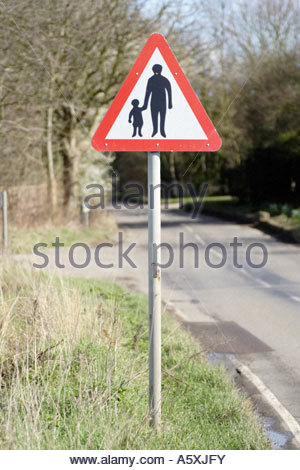 Pedestrians in road ahead sign. - Stock Photo