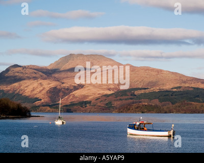 Ben Lomond from across Loch Lomond at Luss pier in Loch Lomond and the Trossachs 'National Park'  Luss Argyll Bute - Stock Photo