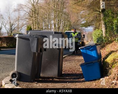 Kerbside re-cycling boxes beside 2 wheelie bins on roadside.  Scotland UK - Stock Photo