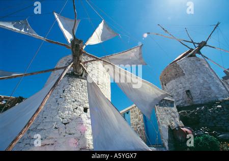 Low angle view of ancient windmills, Olympos, Karpathos, Greece - Stock Photo