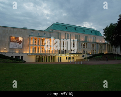 lightened Philharmonic Concert Hall of the town Essen in the evening - Stock Photo