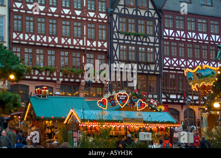 Christmas fair on the square Roemer Römer in front of storefronts of half timbered houses in Frankfurt am Main Hessen - Stock Photo