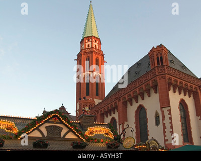 Christmas fair on the square Roemer Römer Römerberg booths stalls in front of the Old Nikolai Church Alte Nikolaikirche - Stock Photo