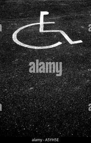 wheel chair sign for disabled drivers in car park - Stock Photo