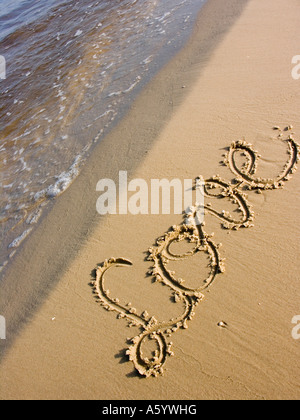 love message written on sand at a beach - Stock Photo