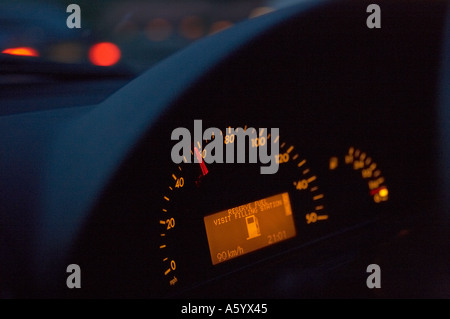 CAR DASHBOARD INSTRUMENTS SHOWING SPEEDOMETER AND LOW FUEL WARNING