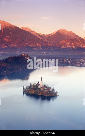 LAKE BLED High view vista The island and church on a perfect still Lake Bled at red sunset with autumn colour Julian - Stock Photo