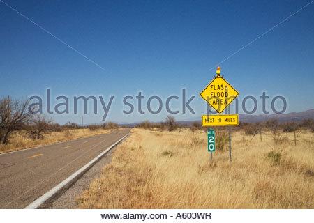 Highway warning sign Flash Flood Area Next 10 Miles - Stock Photo