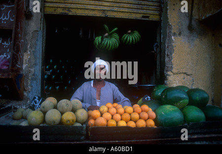 EGYPT Upper Egypt Luxor Fruit vendor outside shop selling green bananas water melons and oranges - Stock Photo