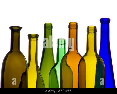 EMPTY WINE BOTTLES VARIETY COLOURFUL  Selection of colourful empty wine bottles in front of a landscape horizontal - Stock Photo