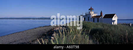 West Point Light Station on Puget Sound with the Olympic Mountain Range in background Seattle Washington USA - Stock Photo