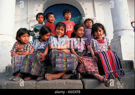 Maya girls from Santiago Atitlan donning the tribal dress of their community The boys now wear Western clothes Guatemala - Stock Photo