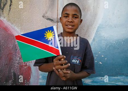Painet jj1763 namibia child kid holding national flag bernard nordkamp youth center katatura black township windhoek - Stock Photo
