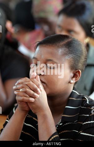 Painet jj1768 namibia woman female praying catholic church service wanaheda parish windhoek 2 africa subsahara aids - Stock Photo