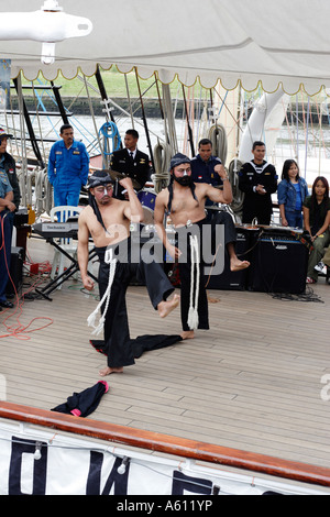 Indonesian sailors dancing on the deck De Waruci sail training ship - Stock Photo