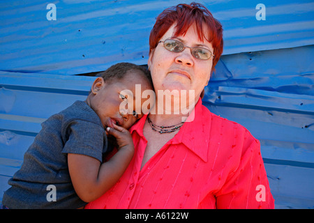 Painet jj1786 namibia woman female child kid standing preschool building rehobeth 2 sad face country developing - Stock Photo