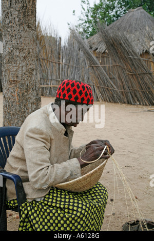 Painet jj1796 namibia old woman female making basket nyangana small village mission station north country angolan - Stock Photo