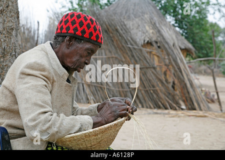 Painet jj1797 namibia old woman female making basket nyangana small village mission station north country angolan - Stock Photo