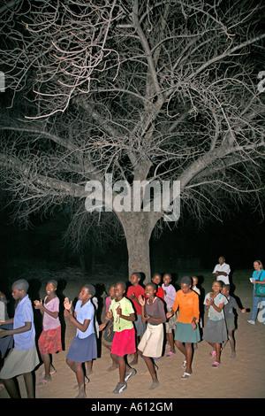 Painet jj1807 namibia girls dancing under tree nyangana small village mission station north country angolan border - Stock Photo