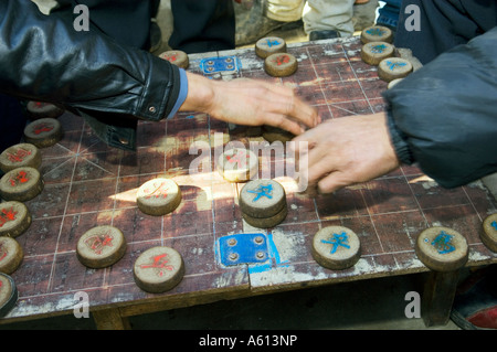 Men playing Chinese checkers board game in farming village of Hui Wen in Shandong Province China - Stock Photo