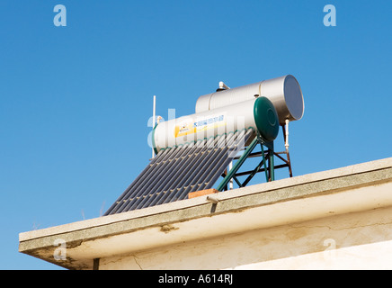 Solar Power Powered Hot Water Heater Tank On House Roof In