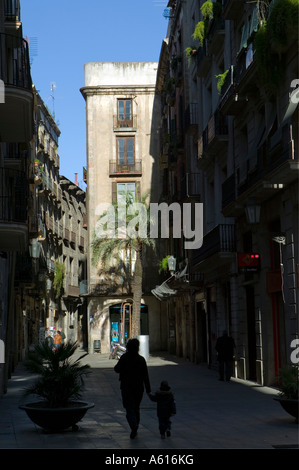 Mother and child in silhouette walking along street Carrer Montcada Born district La Ribera Barcelona Catalonia - Stock Photo