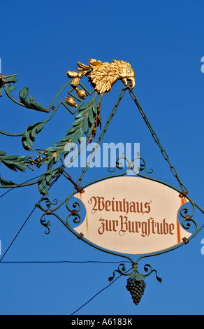 Sign of the wine tavern Burgstube, Wasserburg, Bavaria, Germany - Stock Photo