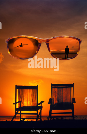 sunglasses with two beach chairs in sunset - Stock Photo